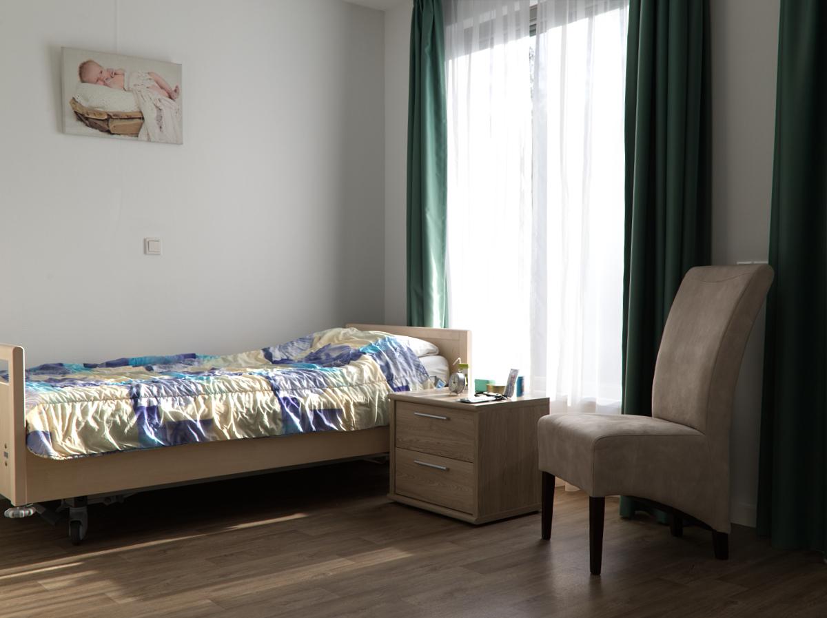 Slaapkamer van een van de appartementen in Kroondomein
