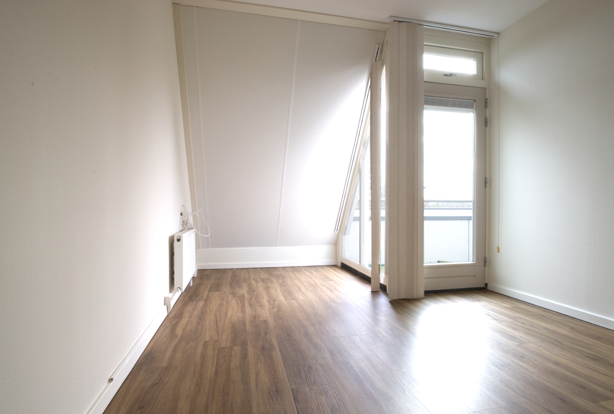 De slaapkamer van het appartement.